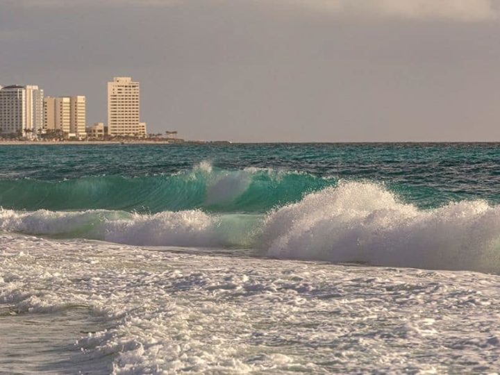 Cancun beach with buildings in the background