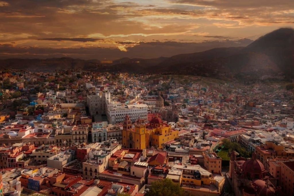 AERIAL VIEW OF GUANAJUATO CITY AT SUNSET WITH THE CHURCH IN THE MIDDLE