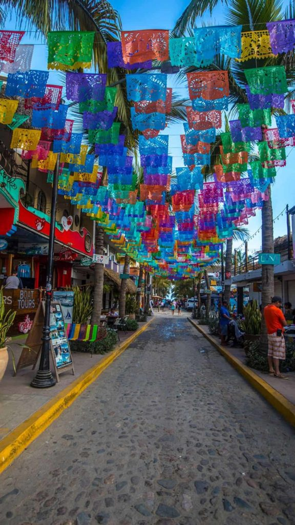 Sayulita twn centr with paper flags hang across the street