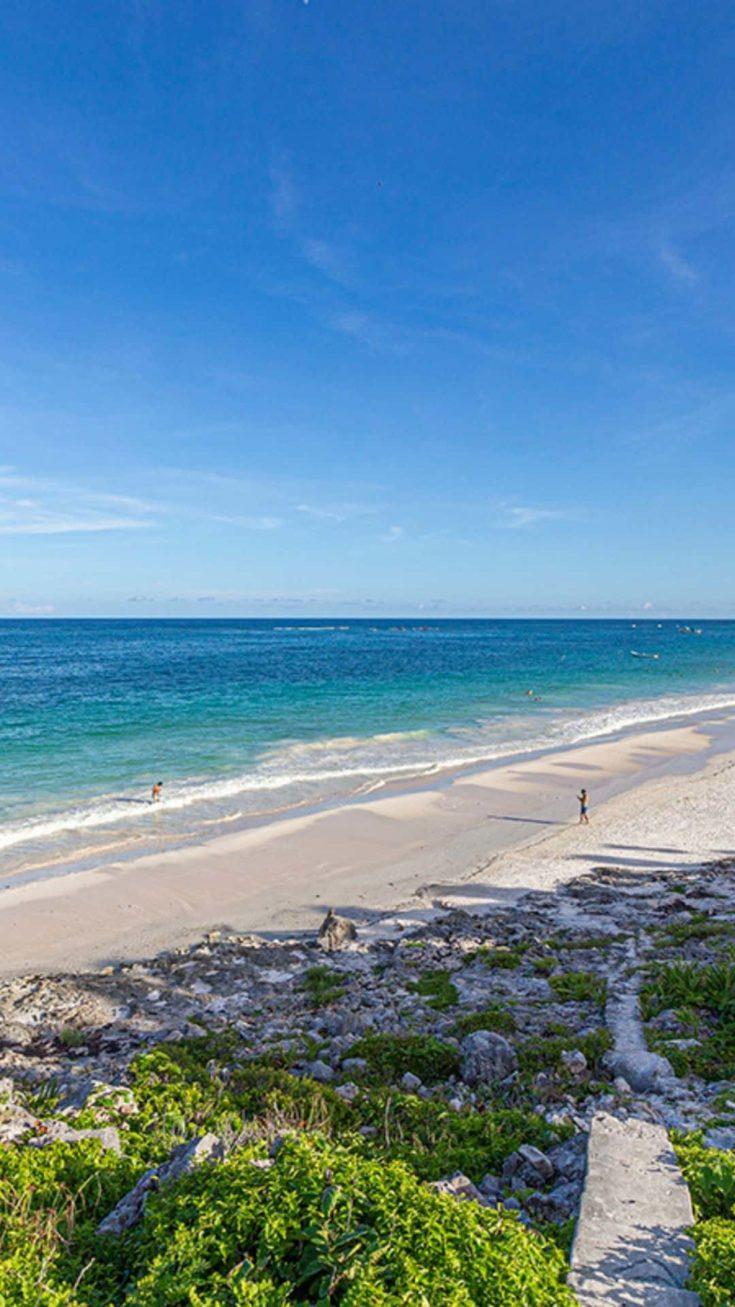 Things to do in Tulum - a girl walking on the beach