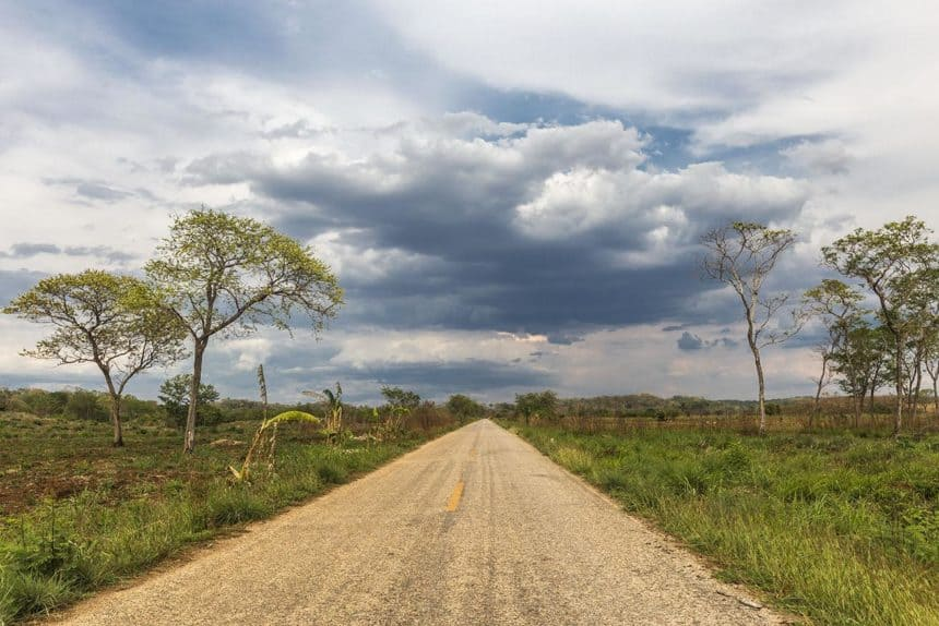 road in the countryside with a cloudy sky