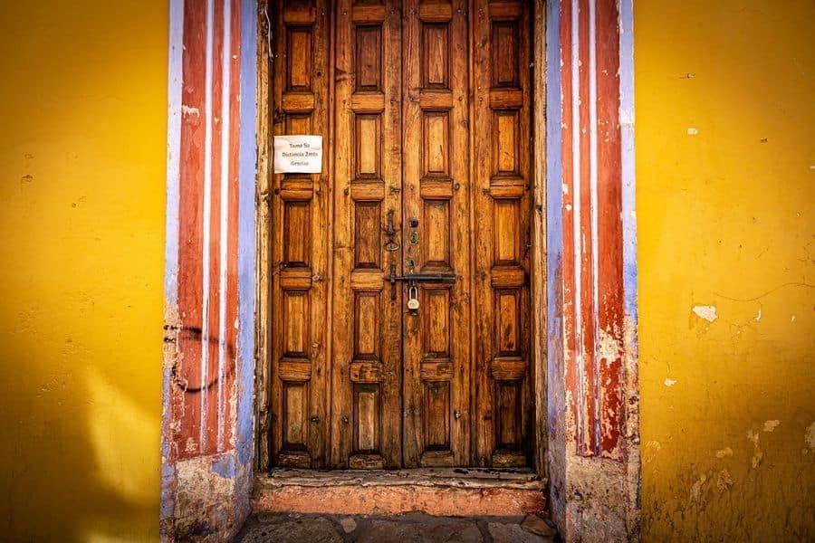 Old door and orange wall