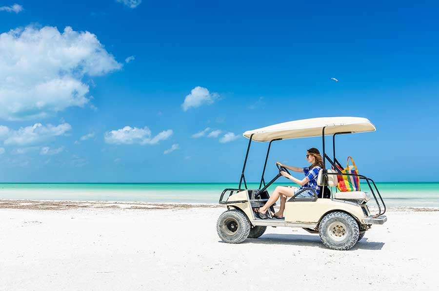 isla mujeres golf cart on the beach