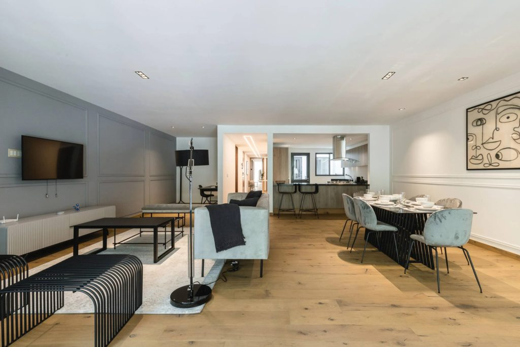 luxury spacious livingroom and kitchen with wooden floor