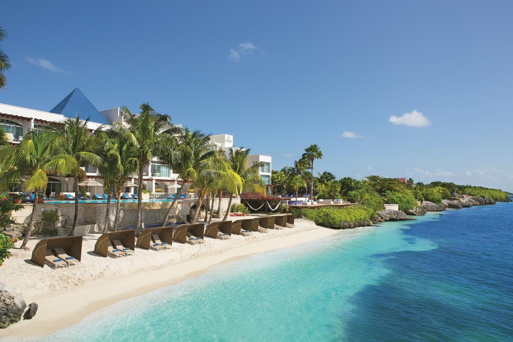 hotel beach with sun beds and sun shades