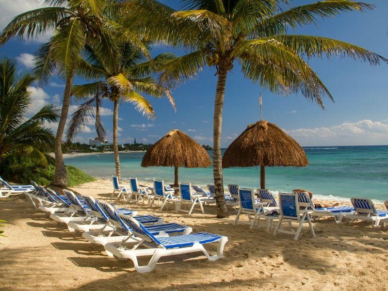Beach with sun shades and beach chairs on Akumal Beach