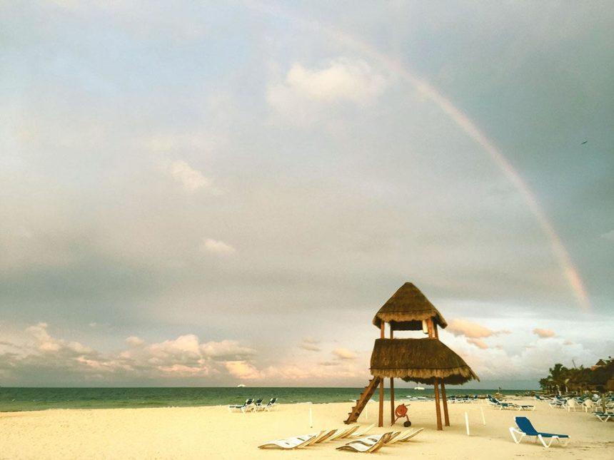 beach with rainbow in the sky