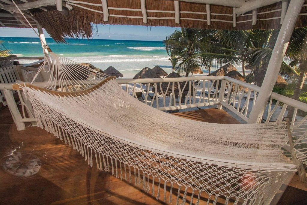 hotel hammock on a verandah with beach view