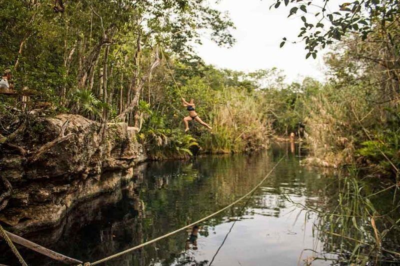 Cenote escondido near Tulum - girl jumping