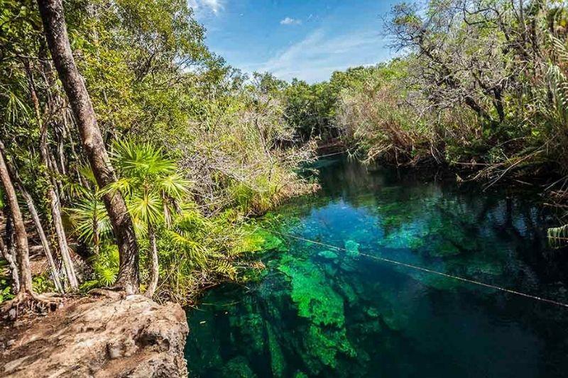Cenote Escondido near Tulum blue sky