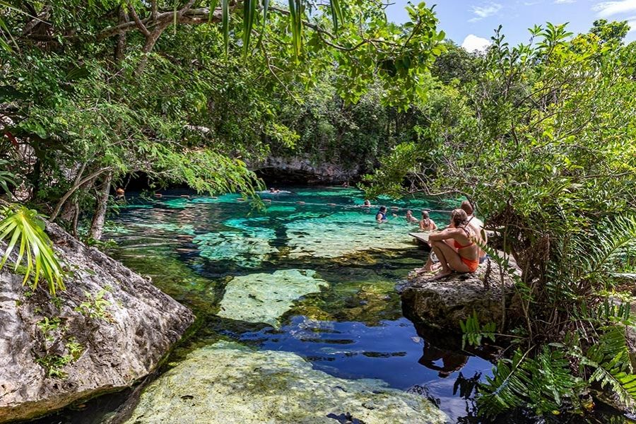 cenote azul, couple sitting by the pool